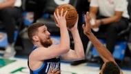 Oklahoma City Thunder guard Svi Mykhailiuk, left, goes to the basket as Utah Jazz center Rudy Gobert (27) defends in the second half of an NBA basketball game Friday, May 14, 2021, in Oklahoma City. (AP Photo/Sue Ogrocki)