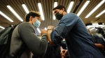 Prime Minister Justin Trudeau greets commuters at a Montreal Metro station on Tuesday, Sept. 21, 2021. THE CANADIAN PRESS/Sean Kilpatrick