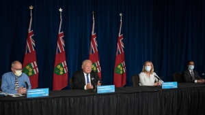 Ontario Premier Doug Ford, second left, responds to a question as Dr. Kieran Moore, Chief Medical Officer of Health,  Christine Elliott, Deputy Premier and Minister of Health, and Kaleed Rasheed, Associate Minister of Digital Government,   listen, during a press conference at Queen's Park in Toronto  on Wednesday, September 1, 2021.  THE CANADIAN PRESS/ Tijana Martin
