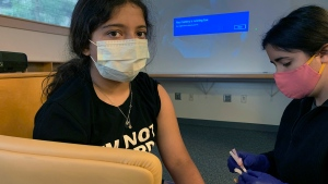 This photo provided by Nisha Gandhi shows Maya Huber taking part in Pfizer COVID-19 vaccine study at Rutgers University on June 14 2021 in New Brunswick, N.J. Maya does not know if she is receiving the vaccine or the placebo. Pfizer says its COVID-19 vaccine works for children ages 5 to 11. The vaccine maker said Monday, Sept. 20, it plans to seek authorization for this age group soon in the U.S., Britain and Europe. The vaccine made by Pfizer and its German partner BioNTech already is available for anyone 12 and older.  (Nisha Gandhi via AP)