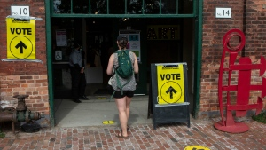 A voter enters a poling station to cast their ballot in Toronto's Spadina-Fort York district on Monday September 20 , 2021. THE CANADIAN PRESS/Chris Young