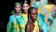 A model wears a creation of Joy Meribe's Spring Summer 2022 collection, unveiled during the Milan Fashion Week, in Milan, Italy, Wednesday, Sept. 22, 2021. (AP Photo/Luca Bruno)