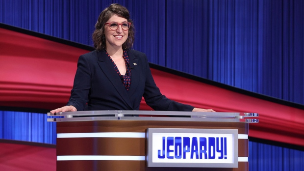 """This image released by Jeopardy! shows Mayim Bialik hosting the game show series """"Jeopardy!,"""" on Aug. 24, 2021. (Carol Kaelson/Jeopardy! via AP)"""
