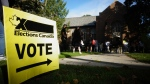People start to line up early for the Canadian general election before polls open in west-end Toronto for the Monday, Sept. 20, 2021. THE CANADIAN PRESS/Graeme Roy