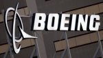 FILE - This Jan. 25, 2011, file photo, shows the Boeing Company logo on the property in El Segundo, Calif. Chicago-based aerospace giant Boeing has announced plans to build a new type of drone military aircraft in Australia. Boeing said Wednesday, Sept. 22, 2021 it has selected Toowoomba city in Queensland state as the final assembly point for its unmanned Loyal Wingman planes. The first test flights were completed earlier this year. (AP Photo/Reed Saxon, File)