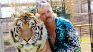 "Joseph Maldonado-Passage aka Joe Exotic and one of his cats in the Netflix docuseries ""Tiger King: Murder, Mayhem and Madness."" (Courtesy Netflix)"