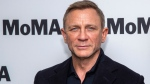 """In this Tuesday, March 3, 2020 file photo, Daniel Craig attends the opening night of the """"In Character: Daniel Craig,"""" film series at the Museum of Modern Art, in New York. Britain's Royal Navy said Thursday Sept. 23, 2021, that James Bond star Daniel Craig has been made an honorary commander in the service — the same rank held by the fictional secret agent. (Photo by Charles Sykes/Invision/AP, File)"""