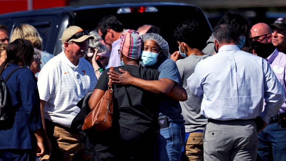 People embrace following a shooting at a Kroger's grocery store in Collierville, Tenn., on Thursday, Sept. 23, 2021. (Patrick Lantrip/Daily Memphian via AP)