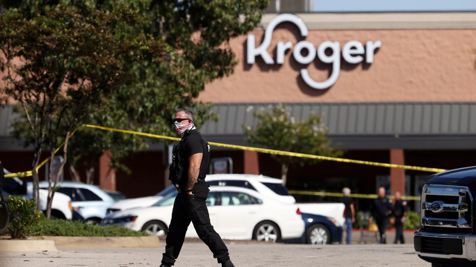 Police respond to the scene of a shooting at a Kroger's grocery store in Collierville, Tenn., on Thursday, Sept. 23, 2021. (Joe Rondone/The Commercial Appeal via AP)