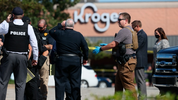 Law enforcement responds to the scene of a shooting at a Kroger's grocery store in Collierville, Tenn., on Thursday, Sept. 23, 2021. (Joe Rondone/The Tennessean via AP)