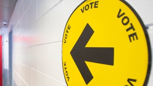 An arrow points to where people can go to cast their ballots on federal election day, Monday, September 20, 2021. THE CANADIAN PRESS/Graham Hughes