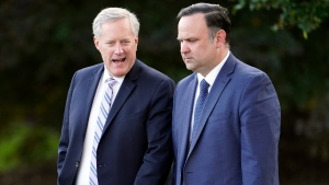 White House chief of staff Mark Meadows and White House social media director Dan Scavino walk to board Marine One with President Donald Trumpon the South Lawn of the White House, Tuesday, Sept. 22, 2020, before leaving for a short trip to Andrews Air Force Base, Md., and then onto Pittsburgh for a campaign rally. (AP Photo/Andrew Harnik)