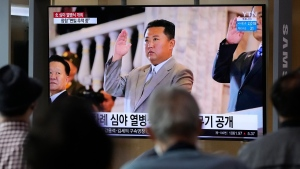 People watch a TV showing North Korean leader Kim Jong Un during a military parade held in Pyongyang, North Korea, at Seoul Railway Station in Seoul, South Korea, Thursday, Sept. 9, 2021. (AP Photo/Ahn Young-joon)