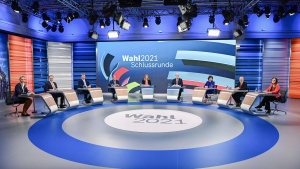 Candidates for the upcoming German election attend a final televised debate in Berlin, Thursday Sept. 23, 2021, ahead of the election on Sunday. From left to 4th left, Alice Weidel, Alice Weidel, co-leader of the Alternative for Germany party (AfD), Christian Lindner, leader of the Free Democratic Party (FDP), Markus Soeder, Christian Social Union party leader and Bavarian Prime Minister, Armin Laschet, chairman of the German Christian Democratic Union. From 3rd right to right, Annalena Baerbock, Green Party co-leader, Olaf Scholz, Finance Minister and SPD candidate, and Janine Wissler, co-leader of the left party Die Linke. (Tobias Schwarz/Pool via AP)