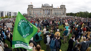 Activist gather for a Fridays for Future global climate strike in front of the parliament building in Berlin, Germany, Friday, Sept. 24, 2021. (AP Photo/Michael Sohn)