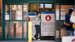 Peter Lougheed Centre hospital staff wait to screen essential visitors who are the only visitors permitted in Alberta hospitals as part of COVID-19 precautions in Calgary, Alta., Thursday, April 9, 2020. THE CANADIAN PRESS/Jeff McIntosh