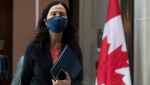 Chief Public Health Officer Theresa Tam makes her way to a news conference, Tuesday, January 12, 2021 in Ottawa. THE CANADIAN PRESS/Adrian Wyld