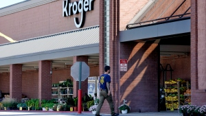 An FBI agent enters a Kroger grocery store Friday, Sept. 24, 2021, in Collierville, Tenn. Police say a gunman, who has been identified as a third-party vendor to the store, attacked people Thursday and killed at least one person and wounded others before being found dead of an apparent self-inflicted gunshot wound. (AP Photo/Mark Humphrey)