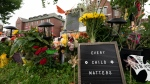 A sign is pictured at a memorial outside the Kamloops Residential School in Kamloops, B.C., Saturday, June, 13, 2021. The remains of 215 children were discovered buried near the former Kamloops Indian Residential School earlier this month. THE CANADIAN PRESS/Jonathan Hayward