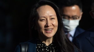 Meng Wanzhou, chief financial officer of Huawei, smiles as she leaves her home in Vancouver on Friday, September 24, 2021. THE CANADIAN PRESS/Darryl Dyck