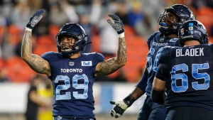 Toronto Argonauts running back D.J. Foster (29) celebrates after scoring a touchdown during first half CFL football action against the Montreal Alouettes in Toronto, Friday, Sept. 24, 2021. THE CANADIAN PRESS/Cole Burston