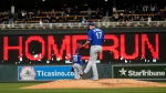 Toronto Blue Jays pitcher Jose Berrios sweeps the mound with his foot after giving up a three-run home run to Minnesota Twins' Byron Buxton in the third inning of a baseball game, Friday, Sept. 24, 2021, in Minneapolis. (AP Photo/Jim Mone)