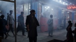 An armed Taliban fighter stands in the corner of a busy street at night in Kabul, Afghanistan, Friday, Sept. 17, 2021. (AP Photo/Felipe Dana)