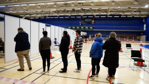 People line-up to vote at a polling station in Gardabae, Iceland, Saturday, Sept. 25, 2021. Iceland is heading to the polls for general elections on Saturday with nine parties running for seats at the North Atlantic island nation's Parliament, or Althing. Polls suggest Prime Minister Katrin Jakobsdottir's Left Green Party could face a poor outcome, ending the current coalition. (AP Photo/Brynjar Gunnarsson)