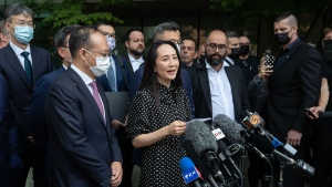 Meng Wanzhou, chief financial officer of Huawei, reads a statement outside B.C. Supreme Court, in Vancouver, on Friday, September 24, 2021. THE CANADIAN PRESS/Darryl Dyck