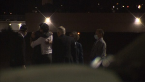 Prime Minister Justin Trudeau hugs an unidentified person on the tarmac where Michael Spavor and Michael Kovrig arrived after more than 1,000 days detained in China.