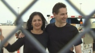 Michael Kovrig and his wife are seen at Toronto Pearson International Airport after returning home following nearly three years of being detailed in China.