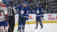 Toronto Maple Leafs' Michael Bunting (58) celebrates his goal against the Montreal Canadiens during the second period of their NHL preseason hockey game in Toronto on Saturday, Sept. 25, 2021. THE CANADIAN PRESS/Jon Blacker