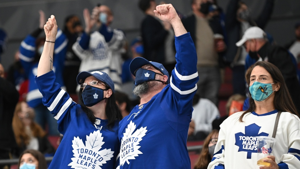 Hockey fans observe COVID-19 protocols during the preseason NHL hockey game between the Toronto Maple Leafs and the Montreal Canadiens in Toronto on Saturday, Sept. 25, 2021. THE CANADIAN PRESS/Jon Blacker