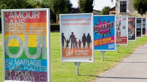 Posters of political parties and associations showing their slogans in Perly near Geneva, Saturday Sept. 25, 2021.. (Salvatore Di Nolfi/Keystone via AP)