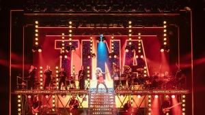 """This image released by Polk & Co. shows Adrienne Warren in a scene """"Tina: The Tina Turner Musical."""" (Manuel Harlan/Polk & Co. via AP)"""