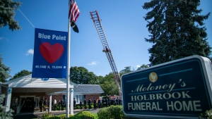 Long Island firefighters attend the funeral service of Gabby Petito at Moloney's Holbrook Funeral Home in Holbrook, N.Y. Sunday, Sept. 26, 2021. (AP Photo/Eduardo Munoz Alvarez)