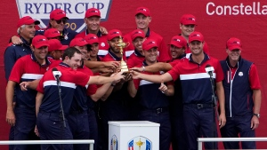 Team USA poses with the trophy at the closing ceremony after the Ryder Cup matches at the Whistling Straits Golf Course Sunday, Sept. 26, 2021, in Sheboygan, Wis. (AP Photo/Jeff Roberson)