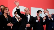 Olaf Scholz, top candidate for chancellor of the Social Democratic Party (SPD) waves to his supporters after German parliament election at the party's headquarters in Berlin, Sunday, Sept. 26, 2021. (AP Photo/Lisa Leutner)