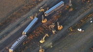 This aerial view taken Sunday, Sept. 26, 2021, shows part of an Amtrak train that derailed in north-central Montana Saturday that killed multiple people and left others hospitalized, officials said Sunday, Sept. 26, 2021. The westbound Empire Builder was en route to Seattle from Chicago, with two locomotives and 10 cars, when it left the tracks about 4 p.m. Saturday. (Larry Mayer/The Billings Gazette via AP)