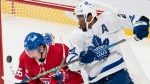 Montreal Canadiens' Rafael Harvey-Pinard, left, and Toronto Maple Leafs right wing Wayne Simmonds (24) keep their eyes on the puck during third period pre-season NHL hockey action in Montreal, Monday, Sept. 27, 2021. THE CANADIAN PRESS/Ryan Remiorz