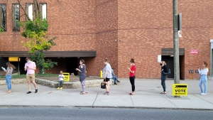 Voters queue outside the Toronto Reference Library on Sept. 20, 2021. (Chris Herhalt/CP24)