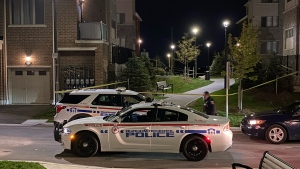 Police vehicles are seen on Dragonfly Avenue after a homicide on Sept. 28, 2021. (Mike Nguyen/CP24)