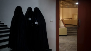 Women stand inside an auditorium at Kabul University's education center during a demonstration in support of the Taliban government in Kabul, Afghanistan, Saturday, Sept. 11, 2021. (AP Photo/Felipe Dana)