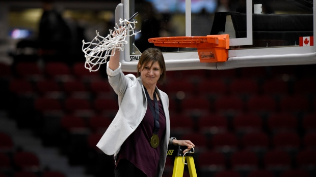 University of Saskatchewan Huskies head coach Lisa Thomaidis waves the net at her athletes as she finishes cutting it down after her team's win over the Brock Badgers in women's championship final basketball game of the U Sports Final 8 Championships, in Ottawa, on Sunday, March 8, 2020. THE CANADIAN PRESS/Justin Tang