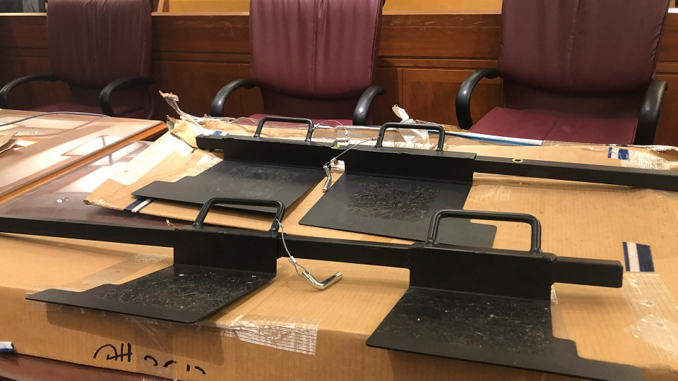 Two devices used as door barricades recovered at the site of the Capital Gazette newspaper during a mass shooting in 2018 are shown in a courtroom Tuesday, June, 29, 2021 in Annapolis, Md., as evidence during the insanity phase of the trial for Jarrod Ramos, who has pleaded guilty but not criminally responsible to killing five at the newspaper three years ago. Authorities say Ramos used a barricade to prevent people from escaping through a back door in the office. (AP Photo/Brian Witte)