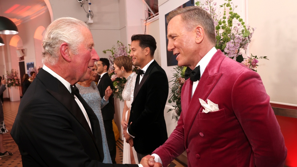 """Britain's Prince Charles, left, meets some of the cast including actor Daniel Craig, right, at the world premiere of the new James Bond film """"No Time To Die"""" at Royal Albert Hall in London, Tuesday, Sept. 28, 2021. (Chris Jackson/Pool Photo via AP)"""