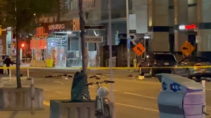Debris is pictured on Bloor Street following a controlled detonation of an unknown object.