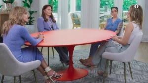 """This image released by Facebook Watch shows co-hosts, from left, Lili Estefan, Gloria Estefan and Emily Estefan with guest Clare Crawley during a taping of """"Red Table Talk: The Estefans."""" In the episode """"Betrayed by Trusted Adults,"""" posted Thursday on Facebook Watch, Gloria Estefan revealed that she was sexually abused by someone her mother trusted when she was 9 years old. Crawley, the first Latina """"Bachelorette,"""" spoke about being abused by a priest when she was young. (Facebook Watch via AP)"""