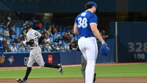 New York Yankees' Aaron Judge (99) rounds the bases after hitting a solo home run off Toronto Blue Jays pitcher Robbie Ray (38) in the first inning of an American League baseball game in Toronto on Thursday, Sept. 30, 2021. THE CANADIAN PRESS/Jon Blacker