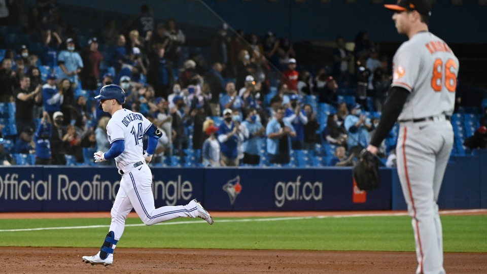 Toronto Blue Jays' Corey Dickerson (14) rounds the bases after hitting a solo home run off Baltimore Orioles' pitcher Brooks Kriske, right, in the sixth American League baseball game against the Baltimore Orioles in Toronto on Friday, Oct. 1, 2021. THE CANADIAN PRESS/Jon Blacker